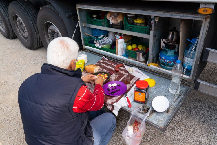 Kirikkale/Turkey-October 27 2019: Truck driver takes a break in his portable kitchen with cupboards of food while resting